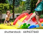 boy playing in kids pool with... | Shutterstock . vector #669637660
