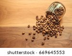 coffee beans in a coffee cup on ... | Shutterstock . vector #669645553