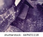 Small photo of Acceleration and break metal pedals details in forklift dashboard