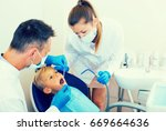 stomatologist man with woman... | Shutterstock . vector #669664636