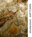 Small photo of close up of rock face very agitated texture