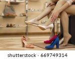 cropped shot of two women... | Shutterstock . vector #669749314