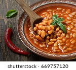 beans in tomato in a dish on a... | Shutterstock . vector #669757120