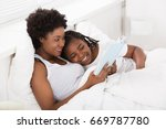 mother reading a bedtime story... | Shutterstock . vector #669787780