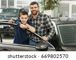 shot of a young boy talking to... | Shutterstock . vector #669802570