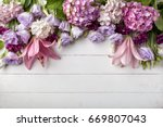 flowers frame on white wooden... | Shutterstock . vector #669807043