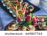 beautifully decorated catering... | Shutterstock . vector #669807763