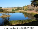 a lake or dam in a rural... | Shutterstock . vector #669809500