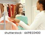 beautiful young woman smiling... | Shutterstock . vector #669810400