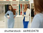 beautiful young woman trying on ... | Shutterstock . vector #669810478