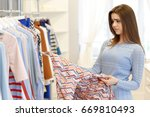 attractive young woman looking... | Shutterstock . vector #669810493