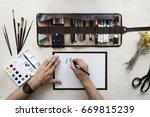 top view on calligrapher hands... | Shutterstock . vector #669815239