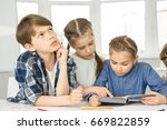 cute little boy looking away... | Shutterstock . vector #669822859