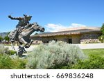 Small photo of CODY, WYOMING - JUNE 24, 2017: Horse and Rider statue at Buffalo Bill Center of the West. A complex of 5 museums and research library featuring natural history, art and artifacts of the American West.