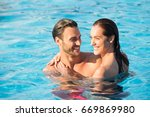 affectionate couple in swimming ... | Shutterstock . vector #669869980