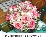 wedding pink bouquet of white... | Shutterstock . vector #669899434