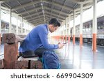 man with smartphone in a train. | Shutterstock . vector #669904309