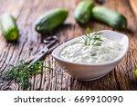 traditional greek dip sauce or... | Shutterstock . vector #669910090