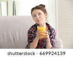 Cute Little Girl Drinking Juic...