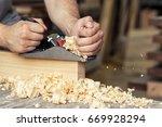 close up as a carpenter... | Shutterstock . vector #669928294