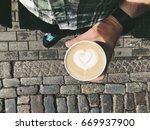 man holding coffee cup ...   Shutterstock . vector #669937900