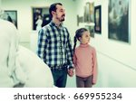 smiling father and daughter... | Shutterstock . vector #669955234