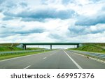 highway view with road and sky | Shutterstock . vector #669957376