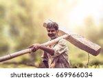 happy indian farmer standing... | Shutterstock . vector #669966034