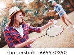 young smiling couple playing... | Shutterstock . vector #669970390