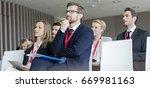business people attending... | Shutterstock . vector #669981163