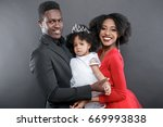 cute african couple with a baby | Shutterstock . vector #669993838