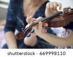 violin lesson. | Shutterstock . vector #669998110