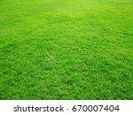 green grass garden in spring.... | Shutterstock . vector #670007404