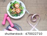 fresh salad and measuring tape... | Shutterstock . vector #670022710