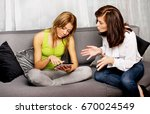 mother and doughter sitting on... | Shutterstock . vector #670024549