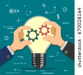 two businessmen hold gears in... | Shutterstock .eps vector #670028164