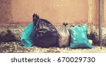 garbage bags abandoned on the...   Shutterstock . vector #670029730