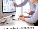 two people analyzing stock... | Shutterstock . vector #670033024