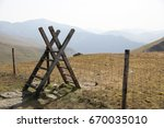 stile over a fence in the misty ... | Shutterstock . vector #670035010