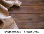 wooden background and burlap | Shutterstock . vector #670052953