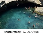 Small photo of Roca Vecchi, Italy June 2017 People swimming and sunbathing in a natural pool on the Adriatic coast.