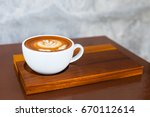 a cup of hot latte art or... | Shutterstock . vector #670112614