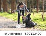 young beautiful volunteer... | Shutterstock . vector #670113400