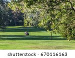 Male Riding Golf Cart