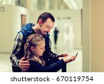 smiling father and daughter... | Shutterstock . vector #670119754