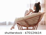 woman sitting in armchair and... | Shutterstock . vector #670124614