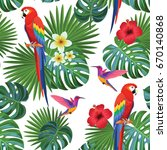 tropical pattern with parrots... | Shutterstock .eps vector #670140868