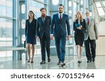 business team walking in modern ... | Shutterstock . vector #670152964