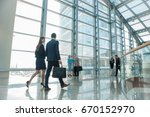 business people walking in... | Shutterstock . vector #670152970