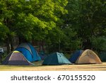 tourist tents in forest camp   Shutterstock . vector #670155520